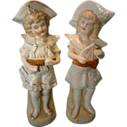 Pair of Porcelain Figures of Children Holding Sailboats