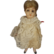 """4 1/2"""" All Bisque Doll House Child with Glass Eyes and Swivel Head"""