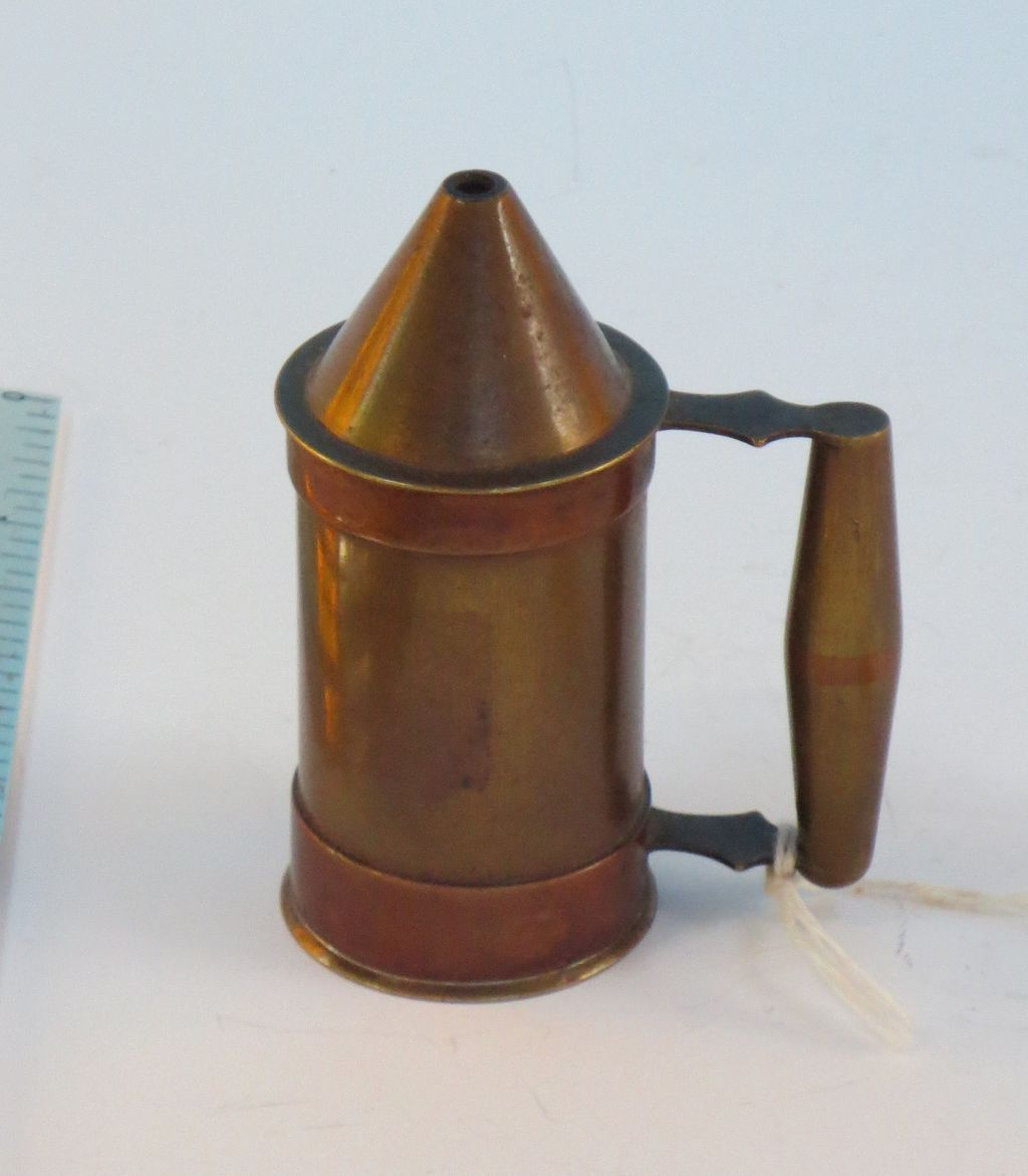 Brass and copper handled canister