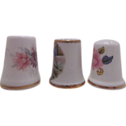 Collection of 3 lovely thimbles, a floral Royal Albert bone china, a floral Camelot bone china & the third is unmarked.