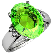 Faceted Peridot Solitaire and Diamond Ring in Fourteen Karat Gold