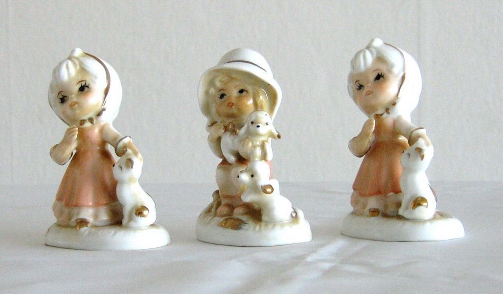 Handpainted Porcelain Children Figurines holding Cat and Dogs