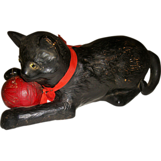 Bretby pottery cat with ball