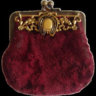 Antique velvet bag with ormolu mount and horseshoe