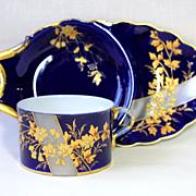 Limoges France cobalt blue cup and saucer/ under plate, raised gold paste flowers, 1882-1890.