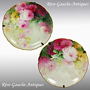 """11.6"""" Pair of hand painted Limoges France chargers with the roses and mums; artist signed """"Bio"""", ca 1890 to 1932"""