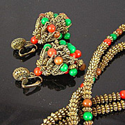 SALE Hattie Carnegie Circa 1960's Red, Green, and Brown Bead in Antiqued Gold Tone Chandelier Earrings and Long Necklace