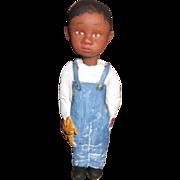 Black primitive doll sculpted by Jude Kapron
