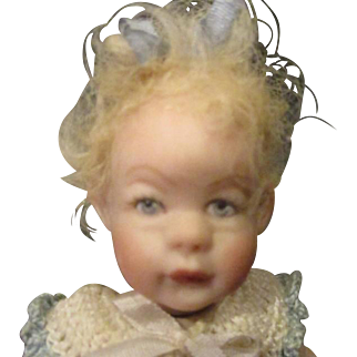 Darling bisque miniature bisque doll