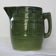 Green Barrel Shaped Pottery Pitcher