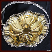 Fruit basket with scalloped and gilded interior:  large, ornate  and on compote style stand