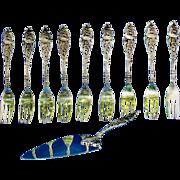 Dessert set of forks and server made of silver in Holland