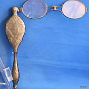 A gunmetal lorgnette is  a different & unique pendant