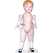 3.75 Inch Wire Jointed  German All Bisque Boy Blond Molded Hair Blue Painted Eyes One Strap Sh