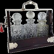 English Victorian Mahogany Tantalus with Three Glass Bottles & Key