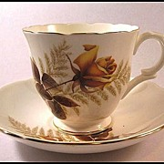 Bone China Teacup and Saucer by Crown Staffordshire with Yellow Roses