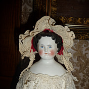 Darling small size antique bonnet with red lining