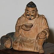 Japanese wood carved okimono of Ebisu god of fishermen sign