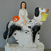 Antique Staffordshire Child Riding Dog With Flower Basket