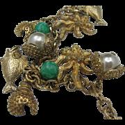Vintage 1960's Sarah Coventry Peking Glass Fish Charm Bracelet