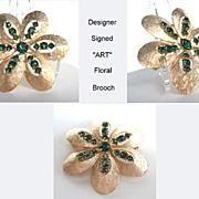 Vintage Designer Signed ART Emerald Rhinestone Floral Brooch Pin Brushed Satin Gold Tone