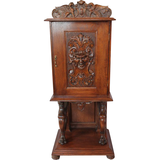 Heavily Carved Quartersawn Oak Parlor Cabinet
