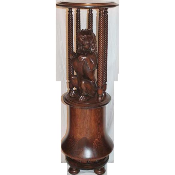 Large         Quartersawn Lion Carved Oak Stand
