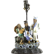 Multi-Figural Mudmen Mounted on Wooden Base, Made Into A Lamp