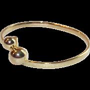 Gold Tone By Pass Bangle Bracelet