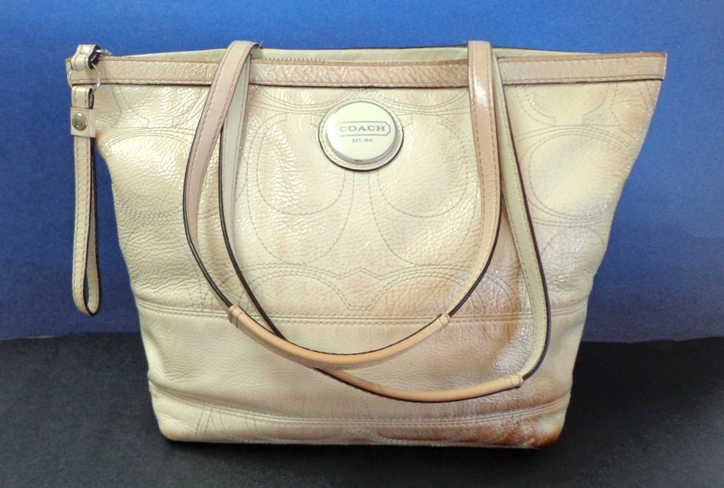 Coach Purse.  Closed tote style.  Cream color. Well Used.
