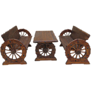 Rustic Wagon Wheel Table and Two Benches with Iron Accents