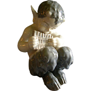 """Royal Copenhagen Figurine """"Faun With A Pan Flute"""" #1736, Sculptured by Christian Tho"""
