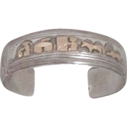 Vintage Navajo Sterling Silver and 14 kt Gold Filled Storyteller Bracelet
