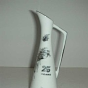Silver and white 25th anniversary pitcher