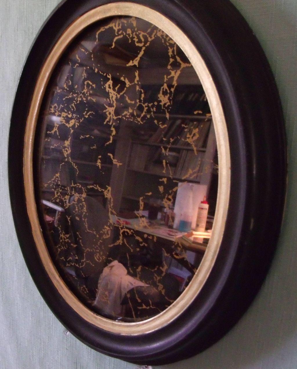 Mirror Marbleized in Gold in Oval Vintage Black Frame