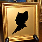 Silhouette of Martha and George Washington  Under Glass on Gold Background