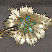 Coro yellow metal leaf pin with prong set iridescent blue stones