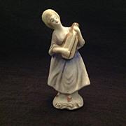 Unglazed bisque figurine lady with mandolin  Japan