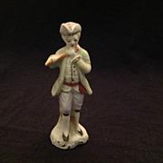 Unglazed bisque figurine man with flute Japan