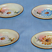 O & E.G. Royal Austria set of 4 oblong salt dips with daisies