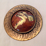 Bold round copper pin with hammered base