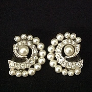 Rhinestone and simulated pearl clip earrings.