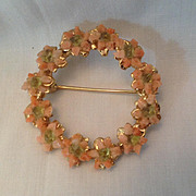 Circle pin inset with pink and green stones