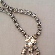 Rhinestone necklace with sparkling three ray pendant