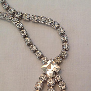 Rhinestone necklace with sparkling three ray pendant