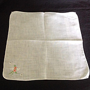 Dainty white handkerchief with coral colored embroidered buds