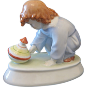 Art Nouveau Ceramic of a playing little girl,ca .1900
