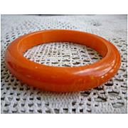 Bright Orange with Yellow Swirls Bakelite Bangle Bracelet