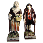 A Large Pair of Early 19th c. Staffordshire Figures of Old Age c. 1810