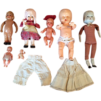 Group of Seven Vintage Dolls - Six Hard Plastic - One Bisque